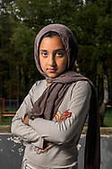 Afghan girl, age 10, in a Serbian refugee camp in Bogovadja. She has 4 brothers. <br /> The Bogovadja buildings have always been a refugee camp. Before, they housed Serbian refugees from Bosnia, Croatia and Kosovo from the Balkan wars.