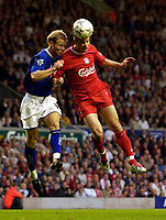 Photo. Jed Wee.<br /> Liverpool v Leicester City, FA Barclaycard Premiership, Anfield, Liverpool. 20/09/2003.<br /> Liverpool's Anthony Le Tallec (R) wins a header from Leicester's Ben Thatcher.
