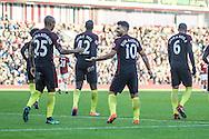 Manchester City midfielder Fernandinho and Manchester City striker Sergio Aguero celebrate during the Premier League match between Burnley and Manchester City at Turf Moor, Burnley, England on 26 November 2016. Photo by Pete Burns.