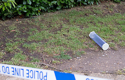 © Licensed to London News Pictures. 09/07/2020. London, UK. A large black knife and an evidence container lying inside a police cordon near Seeley Drive in West Dulwich, South London where a man, believed to be aged 18, was found stabbed to death on Wednesday evening. Photo credit: Ben Cawthra/LNP
