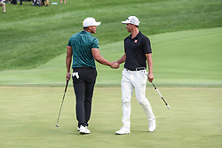 August 12, 2018 - Town And Country, Missouri, U.S - BROOKS KOEPKA from West Palm Beach Florida, USA  gets congratulated by ADAM SCOTT from Australia after clinching the victory on the 18th green during round four of the 100th PGA Championship on Sunday, August 12, 2018, held at Bellerive Country Club in Town and Country, MO (Photo credit Richard Ulreich / ZUMA Press) (Credit Image: © Richard Ulreich via ZUMA Wire)