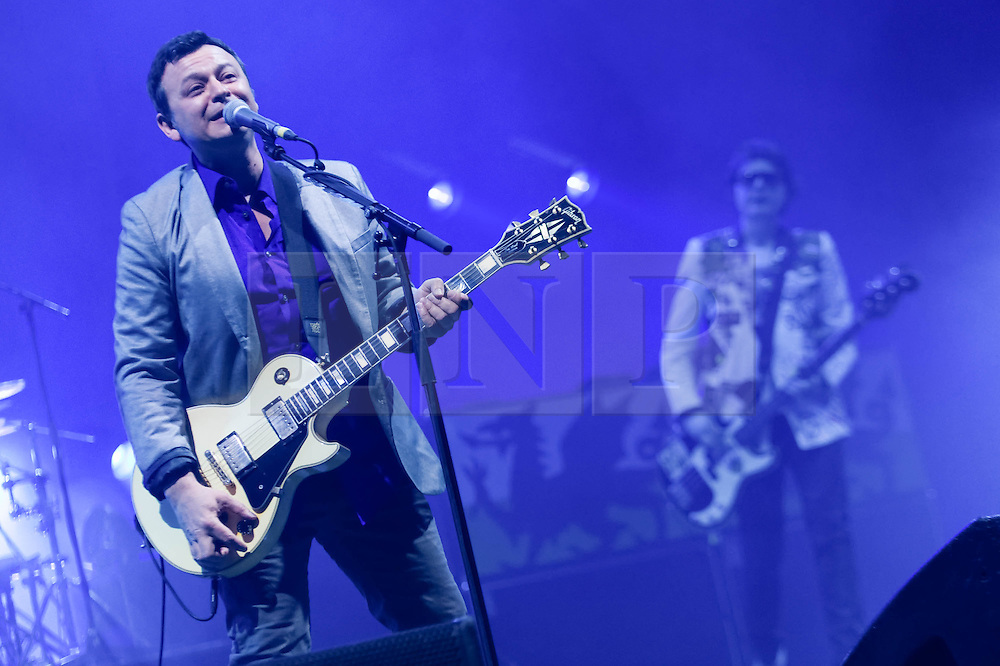 © Licensed to London News Pictures. 11/04/2014. London, UK.   Manic Street Preachers performing live at Brixton Academy.  In this picture - James Dean Bradfield (left), Nicky Wire (right).  Manic Street Preachers are a Welsh alternative rock band consisting of James Dean Bradfield (lead vocals, lead guitar), Nicky Wire (bass guitar, lyrics) and Sean Moore (drums).  Photo credit : Richard Isaac/LNP