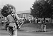 Armed National Guardsman on duty at Little Rock High School, Arkansas during integration troubles of 1956-1957.