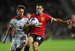 Manchester United's Javier Hernandez battles for the ball with Milton Keynes Dons' George Baldock - Photo mandatory by-line: Joe Meredith/JMP - Mobile: 07966 386802 26/08/2014 - SPORT - FOOTBALL - Milton Keynes - Stadium MK - Milton Keynes Dons v Manchester United - Capital One Cup