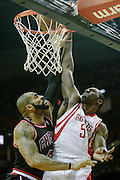 Nov 21, 2012; Houston, TX, USA; Houston Rockets power forward Patrick Patterson (54) shoots against Chicago Bulls power forward Carlos Boozer (5) during the first quarter at the Toyota Center. Mandatory Credit: Thomas Campbell-US PRESSWIRE