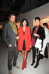 Left to right, Stavros Niarchos, Giovanna Battaglia and SARA BATTAGLIA  at a private view of Nicolas Pol's paintings entitled 'Mother of Pouacrus' held at The Dairy, Wakefield Street, London WC1 on 14th October 2010.