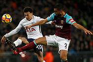 Delle Alli of Tottenham Hotspur (L) battles with Winston Reid of West Ham United (R). Premier league match, Tottenham Hotspur v West Ham United at Wembley Stadium in London on Thursday  4th January 2018.<br /> pic by Steffan Bowen, Andrew Orchard sports photography.