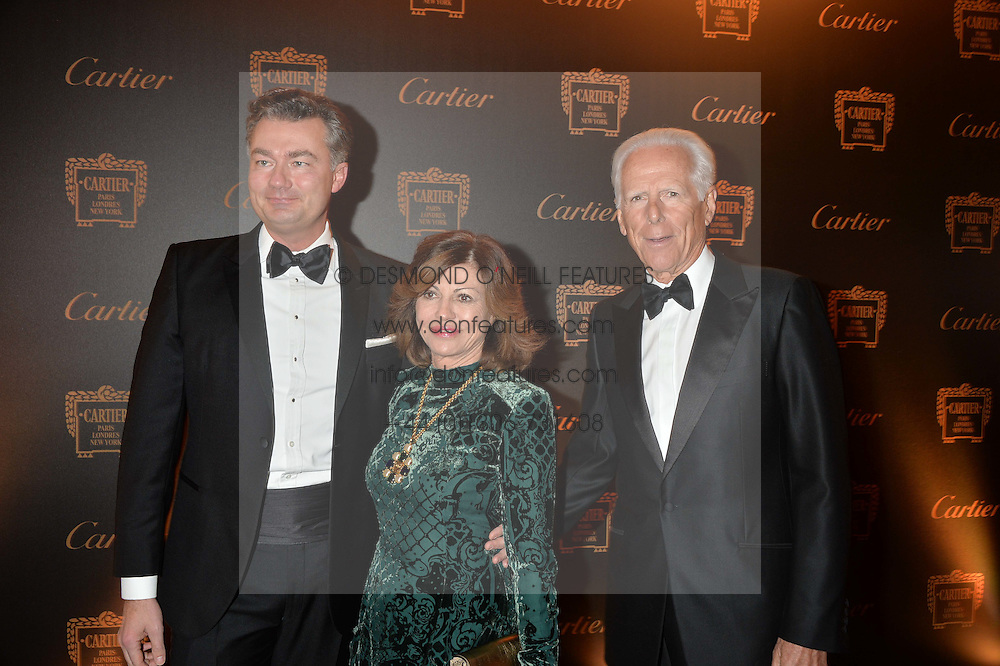 Left to right, LAURENT FENIOU, PILAR BOXFORD and MICHAEL BOXFORD at the 26th Cartier Racing Awards held at The Dorchester, Park Lane, London on 8th November 2016.