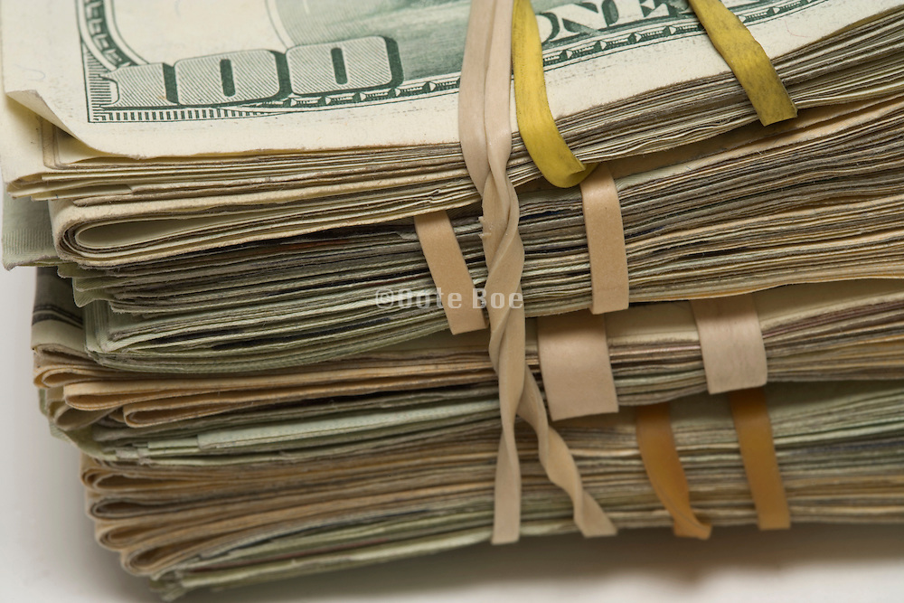 stack with dollar bills hold together with a rubber band