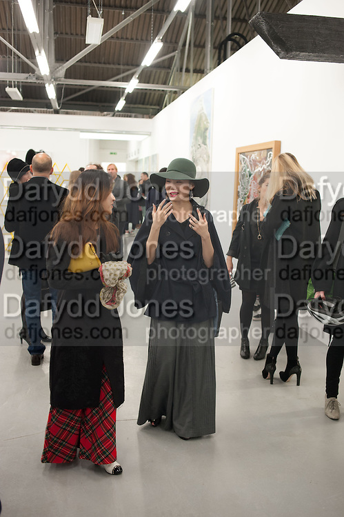 DANIELLA SANCHEZ; YOSUZI SYLVESTER, Frieze week Drinks Party at the opening of the exhibition Island at the Dairy arts Centre, 7a Wakefield Street, Bloomsbury, London. 18 October 2013.