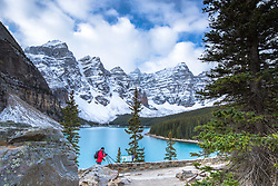 Photographer, Morain Lake in the Valley of the Ten Peaks in Banff National Park.