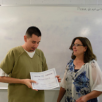 Michael Garcia is presented a certificate from Katrina Marti, a case manager at the McKinley County Adult Detention Center for graduating from a 28-day Treatment Program at the McKinley County Adult Detention Center, Thursday, August 16, 2018.