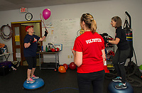 """Volunteer Kate Fox keeps time while Carol Sacknoff and Barbara Lewis work on agility and balance drills during their """"Rock Steady Boxing"""" class at the Downtown Gym Thursday.  (Karen Bobotas/for the Laconia Daily Sun)"""