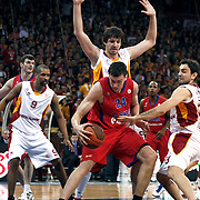 Galatasaray MP's Ender Arslan (R), Preston Shumpert (L) and CSKA Moscow's Sasha Kaun (C) during their Euroleague Top 16 basketball match Galatasaray MP between CSKA Moscow at the Abdi Ipekci Arena in Istanbul at Turkey on Thursday, February, 09, 2012. Photo by TURKPIX