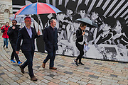 Visitors arrive on a rainy afternoon - Photo London, an international photography event in its third edition, Along with the selection of the world's leading galleries showing at the Fair, Photo London presents the Discovery section for the most exciting emerging galleries and artists. There is also a Public Programme bringing together special exhibitions and talks. The event runs until 21 May. London 17 May 2017.