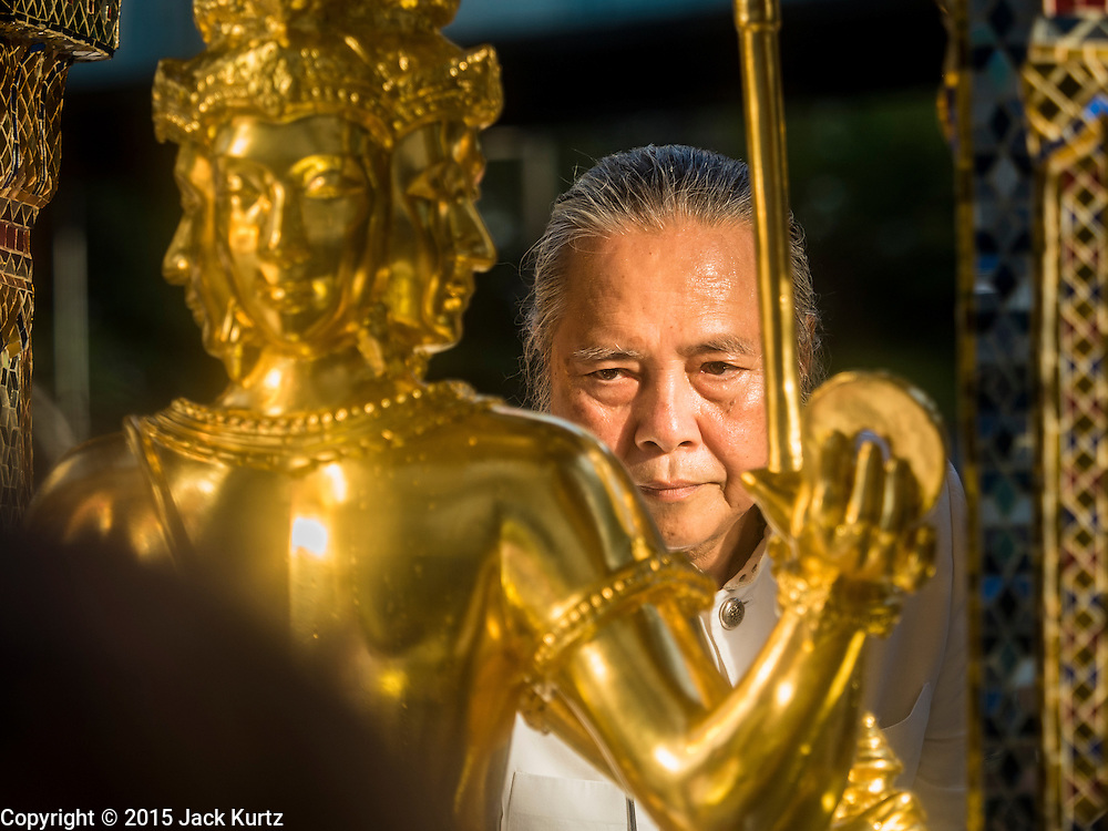 """04 SEPTEMBER 2015 - BANGKOK, THAILAND: PHRAMAHARAJAGURUPHITISRIVISUTTHIKUN, the Royal Priest of Thailand, blesses the Four Faced Brahma statue at the Erawan Shrine during a rededication ceremony Friday. A """"Holy Religious Ceremony for Wellness and Prosperity of our Nation and Thai People"""" was held Friday morning at Erawan Shrine. The ceremony was to regain confidence of the Thai people and foreign visitors, to preserve Thai religious customs and traditions and to promote peace and happiness inThailand. Repairs to Erawan Shrine were completed Thursday, Sept 3 after the shrine was bombed on August 17. Twenty people were killed in the bombing and more than 100 injured. The statue of the Four Faced Brahma in the shrine was damaged by shrapnel and a building at the shrine was damaged by debris.    PHOTO BY JACK KURTZ"""