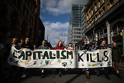"© Licensed to London News Pictures. 01/09/2019. Manchester, UK. Extinction Rebellion Youth march through the Arndale Shopping Centre and through Manchester after holding a "" die-in"" in front of fashion retailers River Island and Next . Extinction Rebellion block roads around Deansgate in Manchester City Centre , during a third day of planned disruption organised by environmental campaigners . Manchester City Council has declared a climate emergency but activists say the council's development plans do not reflect this . Photo credit: Joel Goodman/LNP"