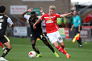 Adam King of Crewe Alexandra gets away from Drissa Traore of Swindon Town. Skybet football league 1 match, Crewe Alexandra v Swindon Town at The Alexandra Stadium in Crewe, Cheshire on Saturday 5th September 2015.<br /> pic by Chris Stading, Andrew Orchard sports photography.