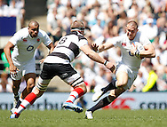 Picture by Andrew Tobin/Tobinators Ltd +44 7710 761829.26/05/2013.Mike Brown of England goes past Imanol Harinordoquy of the Barbarians during the match between England and the Barbarians at Twickenham Stadium, Twickenham.