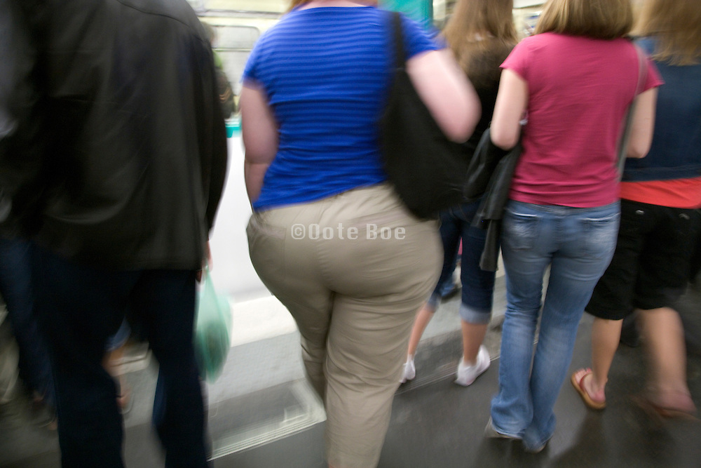 young obese woman seen from behind with group