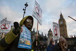 © licensed to London News Pictures. London, UK 01/12/2012. Protester marching to erect a 7.2 metre high fake ?fracking rig? outside parliament to protest against the expansion of hydraulic fracturing for shale gas into the UK Photo credit: Tolga Akmen/LNP