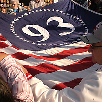 Shanksville, Pennsylvania, Septmeber 11, 2003 - Visitors   to the Temporary Memorial on Sept. 11, 2003 assist in unfolding a gaint flag  honoring the victims of Flight 93 that lost their lives 2 years ago today. (Photo by Archie Carpenter/Getty Images)