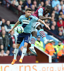 Aston Villa's Jores Okore battles for the high ball with West Ham United's Aaron Cresswell  - Photo mandatory by-line: Joe Meredith/JMP - Mobile: 07966 386802 - 09/05/2015 - SPORT - Football - Birmingham - Villa Park - Aston Villa v West Ham United - Barclays Premier League