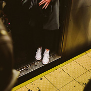 Commuters at the 4, 5 and 6 train platform try to board trains at the Union Square Station in Manhattan, New York on Tuesday, November 14, 2017. The drummer is Larry Wright  and his son dancing is Jeremiah. John Taggart for The New York Times