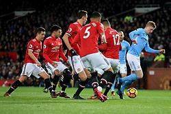 10 December 2017 -  Premier League - Manchester United v Manchester City - Kevin De Bruyne of Manchester City surrounded by Man Utd players - Photo: Marc Atkins/Offside