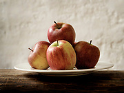 still life with apples on a plate