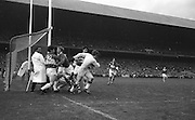 Laois goalie A. Burke fights his way out of goalmouth through Cork players during the All Ireland Minor Gaelic Football Final Cork v. Laois in Croke Park on the 24th September 1967.