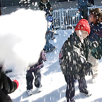 Edgar Garcia, 4, student with Pameroy Elementary School Head Start program, enjoys throwing a snowball in the Jones Plaza, 12/06/02.