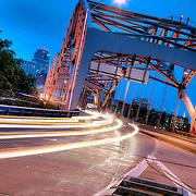 Traffic and motion blur on Kansas City's Broadway Bridge at dusk.