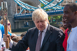 London, June 6th 2014. Mayor of London Boris Johnson joins Olympic and Commonwealth champion Christine Ohuruogu MBE to welcome the Commonwealth GamesQueen's Baton Relay to the Capital.