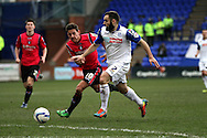 Tranmere Rovers' Danny Holmes goes past Oldham Athletic's Charlie MacDonald. Skybet football league 1match, Tranmere Rovers v Oldham Athletic at Prenton Park in Birkenhead, England on Saturday 1st March 2014.<br /> pic by Chris Stading, Andrew Orchard sports photography.