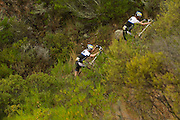 Stefam Sahm and Thomas Dietsch of Team Bulls 3 push their bikes up a steep rocky climb during stage 1 of the 2014 Absa Cape Epic Mountain Bike stage race held from Arabella Wines in Robertson, South Africa on the 24 March 2014<br /> <br /> Photo by Greg Beadle/Cape Epic/SPORTZPICS