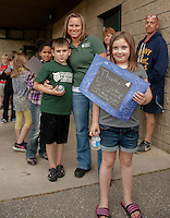 """Pipa Boyle extends a """"thank you"""" to Laconia Police and Fire from all of Mrs. Mull's 2nd grade students from Woodland Heights Elementary School during their Read In / Cookout on Friday afternoon.  (Karen Bobotas/for the Laconia Daily Sun)"""