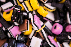 © Licensed to London News Pictures. 12/07/2015. Pontefract, UK. Thousands of people have again turned out in Pontefract to celebrate all things Liquorice including sweets, beer, bread, pies, jam & jewellery . The town famed for the Pontefract cake has a 400 year history with Liquorice, it is believed Cluniac monks brought it to the area in the mid 1500 & introduced it as a medicine. Photo credit : Andrew McCaren/LNP