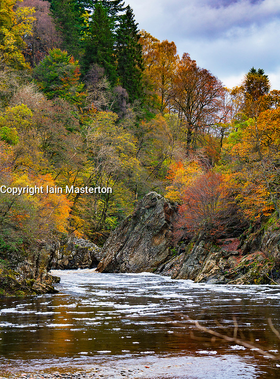 Spectacular autumn colours in natural woodland on banks of River Garry at historic Pass of Killiecrankie at Soldier's Leap  near Pitlochry.