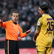 Referee's Cuneyt CAKIR (L) and Trabzonspor's goalkeeper Onur KIVRAK (R) during their Turkey Cup Group B matchday 5 soccer match Besiktas between Trabzonspor at the Inonu stadium in Istanbul Turkey on Wednesday 26 January 2011. Photo by TURKPIX