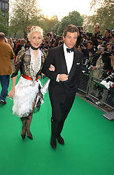 DAPHNE GUINNESS and HUGO DE FERRANTI  at the NSPCC's Dream Auction held at The Royal Albert Hall, London on 9th May 2006.<br />
