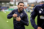 AFC Wimbledon midfielder Andy Barcham (17) warming up before the EFL Sky Bet League 1 match between AFC Wimbledon and Plymouth Argyle at the Cherry Red Records Stadium, Kingston, England on 26 December 2018.