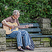We were in Ft Tryon park on a beautiful May day.  This gentleman was enjoying the sunshine and entertaining all who would listen.  He was kind enough to allow me to take this shot.