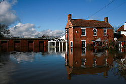© London News Pictures. 24/02/2014. Moorland, UK. Flood water surrounding a property in Moorland on the Somerset Levels, which continues to suffer from sever flooding. Photo credit: Jason Bryant/LNP