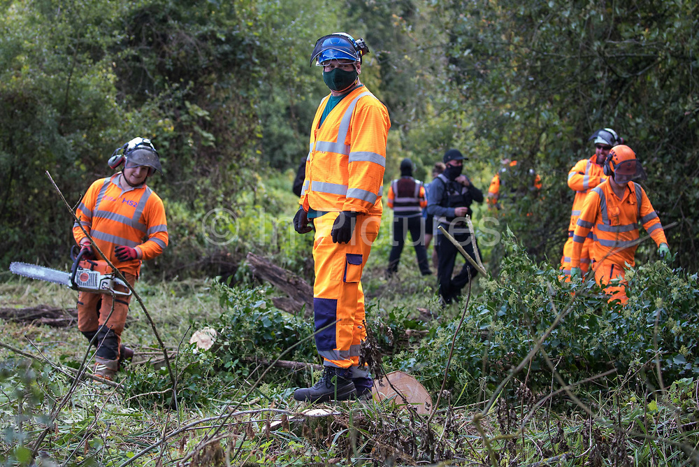 Tree surgeons working on behalf of HS2 Ltd, facilitated by around two dozen security guards, fell trees in Denham Country Park for works connected to the HS2 high-speed rail link on 29 September 2020 in Denham, United Kingdom. Anti-HS2 activists based at the nearby Denham Ford Protection Camp, who are trying to prevent or delay the destruction of the woodland, contend that the area of Denham Country Park currently being felled is not indicated for felling on documentation supplied by HS2 Ltd.