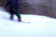 Snowboarder speeding down hill.  Bessemer Ironwood Michigan USA Big Powderhorn