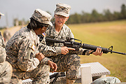 A woman Drill Sergeant candidate is given instruction by a women Drill Sergeant instructor at the US Army Drill Instructors School Fort Jackson during weapons training September 26, 2013 in Columbia, SC. While 14 percent of the Army is women soldiers there is a shortage of female Drill Sergeants.