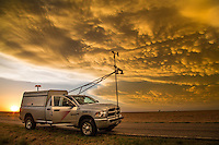 """Storm research vehicle """"Scout 3"""" parked under mammatus clouds, May 24, 2016, near Dodge City, Kansas.  Scout 3 is a vehicle working with Project TWIRL, a research mission to place atmospheric measurement probes in front of tornadoes that are being actively scanned by Doppler radar."""