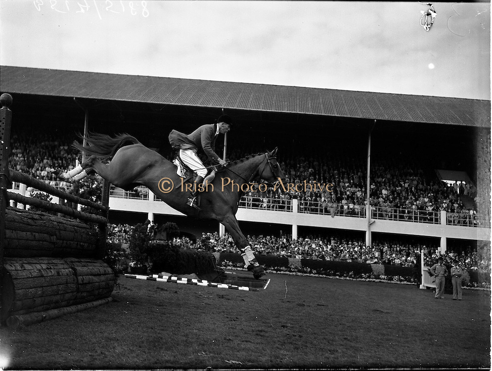 """05/08/1960<br /> 05/08/1960<br /> 05 August 1960<br /> R.D.S Horse Show Dublin (Friday). Aga Khan Trophy. David Broome of Great Britain clearing the last jump in the Aga Khan Trophy on """"Sunsalve"""" at the Dublin Horse Show."""