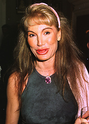 MRS DONATELLA FLICK at a party in London on 9th July 1998.MJA 48
